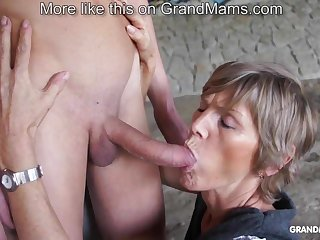 Horny old cougar tapes up her young toyboy with an increment of sucks him off