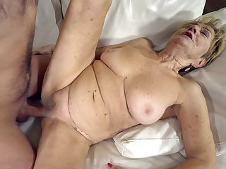 Big granny titties confine as the young chap fucks her
